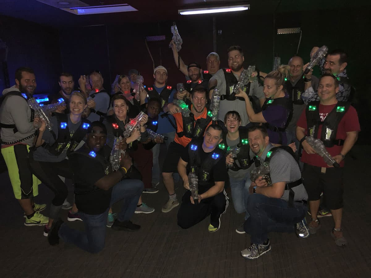 Sunset Employees playing Laser Tag